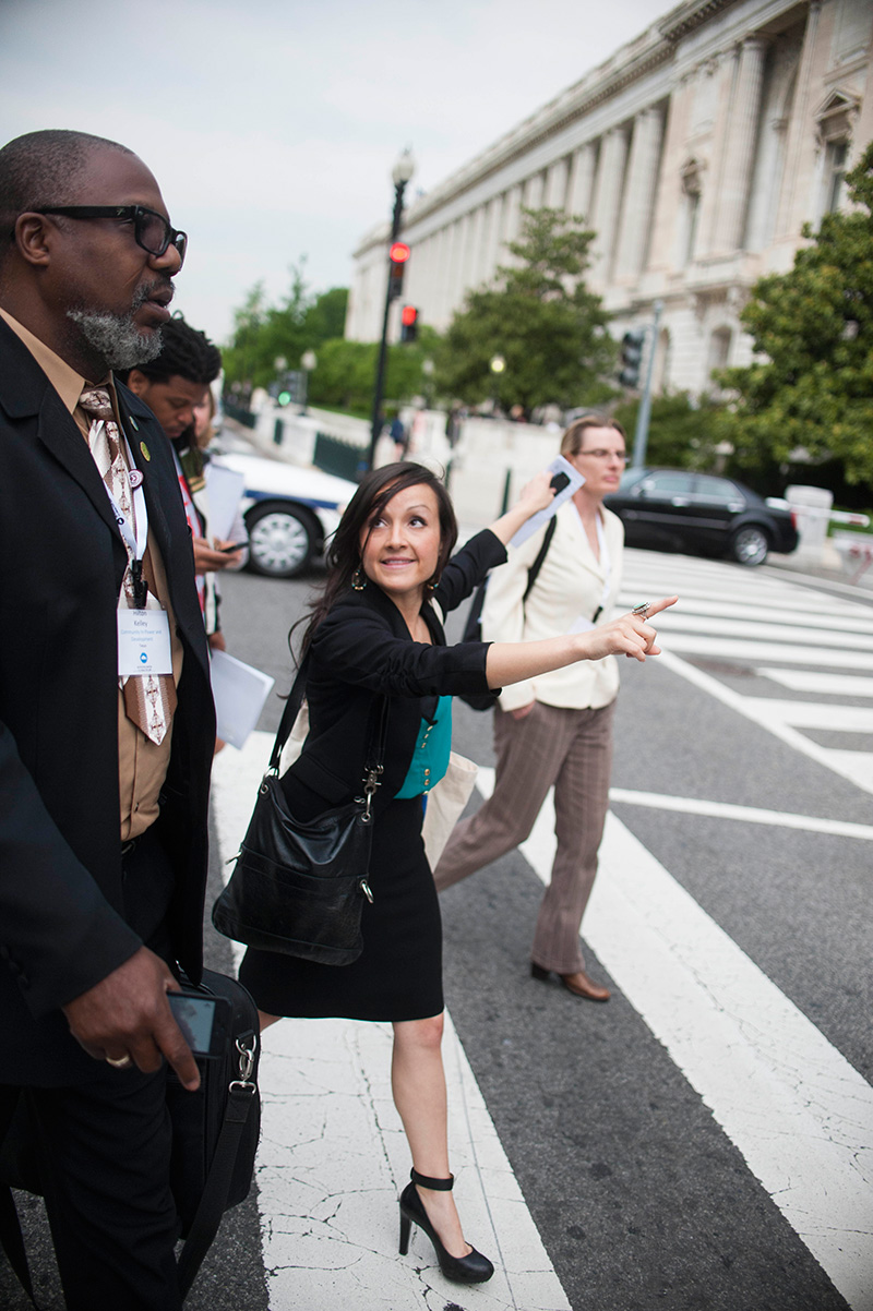 Andrea, center, walks with community lobbyists to meetings in Congress with their senators and representatives.