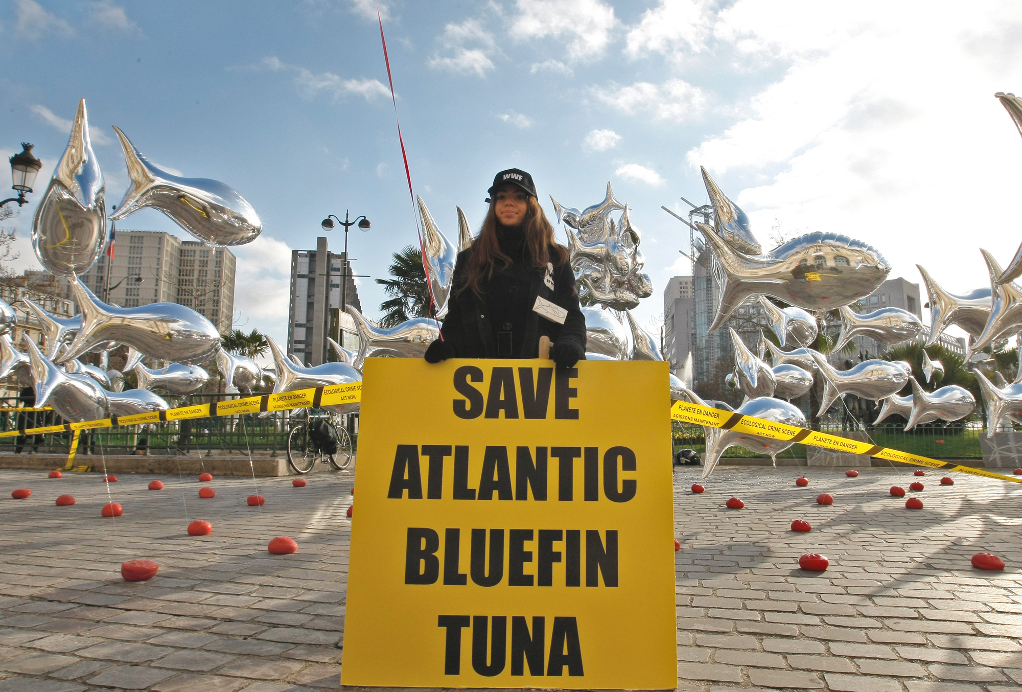 An ocean conservation activist holds a sign reading