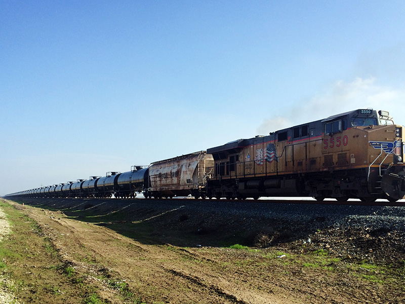 An oil train moves through California's Central Valley. The newly opened Bakersfield Crude Terminal has the capacity to receive two 100-car unit trains a day.