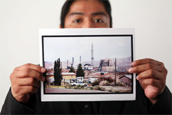 William Anderson holds a photo of the Reid Gardner Power Station. (Chris Jordan-Bloch / Earthjustice)