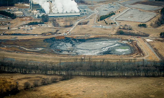 The unlined coal ash pits are located next to the Dan River. (Photo courtesy of Waterkeeper Alliance)