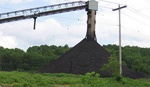 Coal storage area and loading facility near Philippi, WV. Large, uncovered piles of coal sit until they are loaded onto CSX rail or trucks for transport. (Cindy Rank)