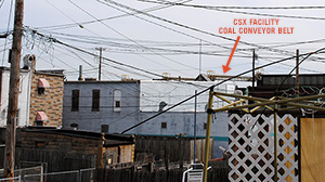 The coal conveyor belts of the CSX coal export facility are visible above the rooftops of Ms. Fox's Curtis Bay neighborhood. Dust blows from the facility and onto surrounding neighborhoods. (Chesapeake Climate Action Network)