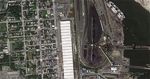 The CSX coal export and processing facility is on the right in this satellite image. The Curtis Bay neighborhood is directly to the left of the facility. (Imagery [c] 2013 Google)
