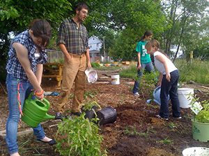 Jason, with his students at the community garden. (Filbert Community Garden)