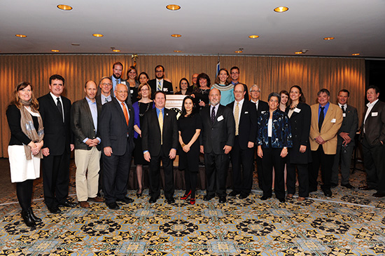 Staff and board members from the more than 20 event host organizations pose with Representative Mike Fitzpatrick of Pennsylvania and Representative Paul Tonko of New York.