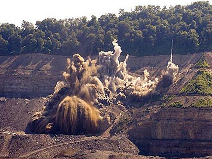 Mountaintop removal mining uses an explosive mixture of ammonium nitrate and fuel oil, commonly called ANFO. Communities located near mountaintop removal sites have reported having their homes bombarded with rocks and other dangerous projectiles from blasting. Photo: Giles Ashford