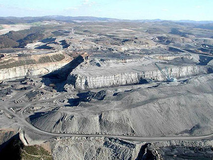 Mountaintop removal mining devastates the landscape, turning areas that should be lush with forests and wildlife into barren moonscapes. The massive dragline in the photo, which can weigh up to 12 million pounds and be as big as an entire city block, is dwarfed by the scale of this devastation. Photo: OVEC
