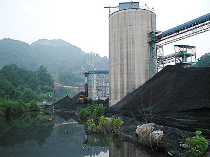 Black coal is processed and cleaned in this West Virginia processing plant. Coal mining in the region destroys mountains and forests, and also creates a witches brew of toxic chemicals in containment ponds such as the one shown here. Photo: OVEC