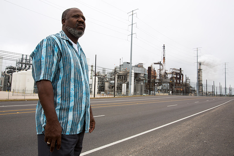 Hilton Kelley stands in front of the Valero refinery on November 21, 2013 in Port Arthur, TX.
