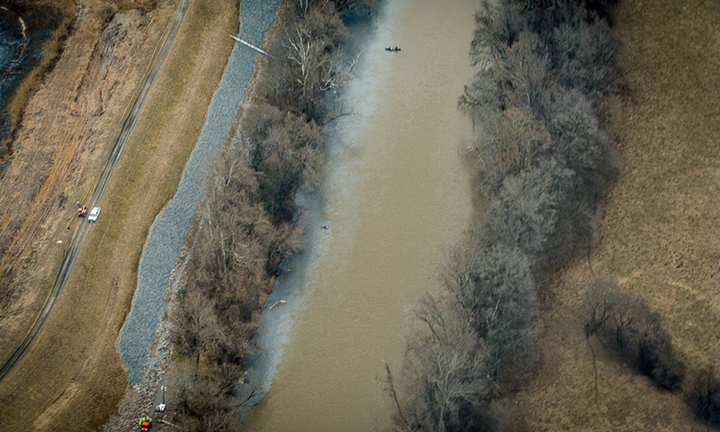 The toxic coal ash turned the Dan River gray for 20 miles east of the North Carolina border in the aftermath of a spill in February 2014.