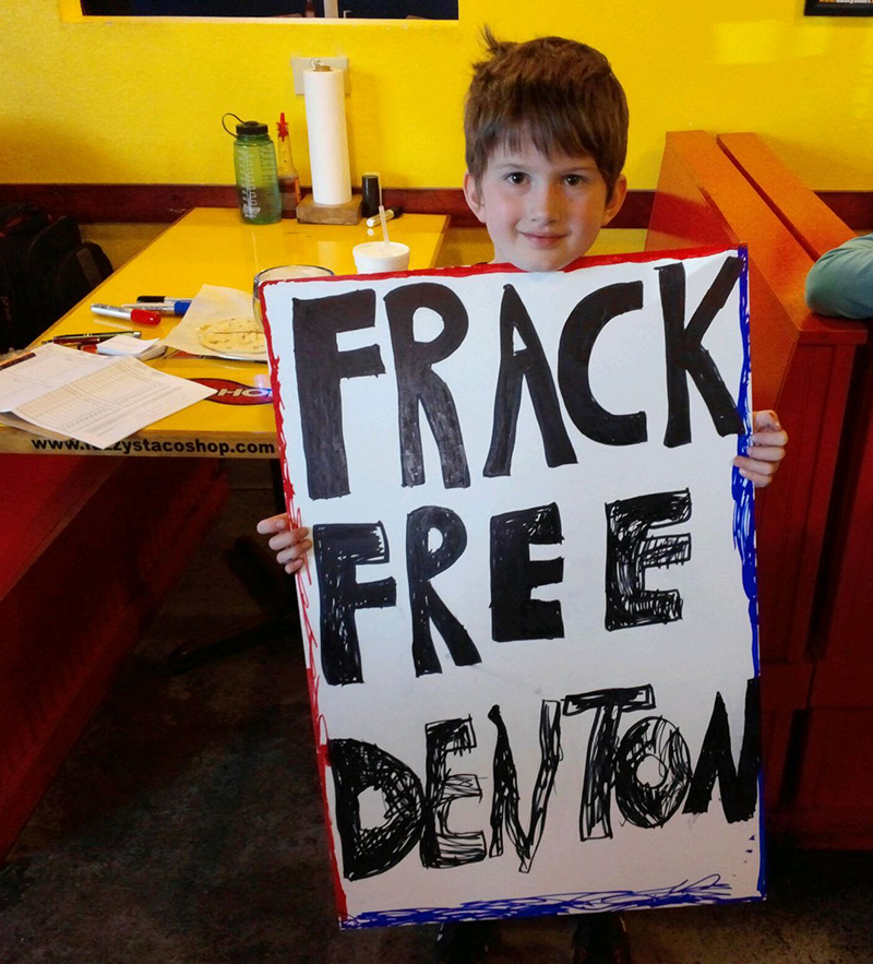 A young fracktivist in Denton, TX. (Photo courtesy of Frack Free Denton)