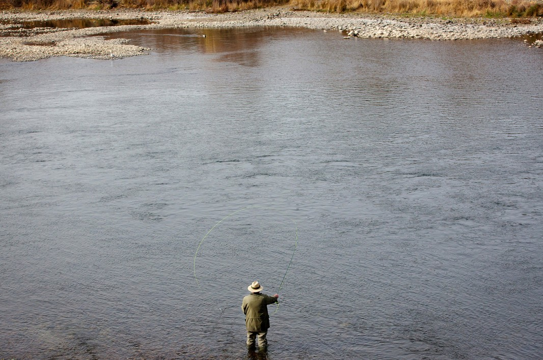 A fly fisherman in the American River casts for salmon near the Nimbus Dam on February 5, 2014.