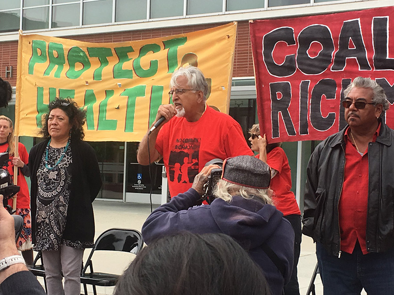 Richmond City Council Member Eduardo Martinez speaks at an event against coal dust in the community.