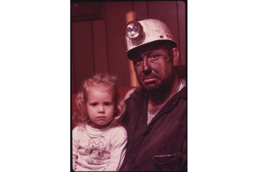 December, 1974: Miner Wayne Gipson, 39, sits with his daughter Tabitha, 3. He has just gotten home from his job as a conveyor belt operator at a non-union mine.