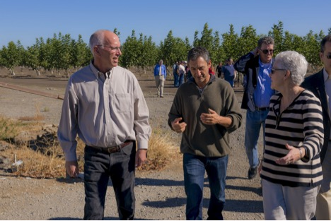 Earthjustice President Trip Van Noppen and EPA Administrator Gina McCarthy tour a tomato and nut farm outside of Sacramento, CA in October, 2015.