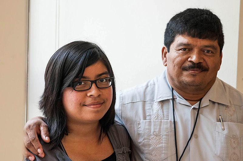 Selena Zelaya, with her father Miguel, at the Rayburn House Building in Washington, D.C., following a meeting with congressional staff to call for stronger protections from pesticides for agricultural workers.