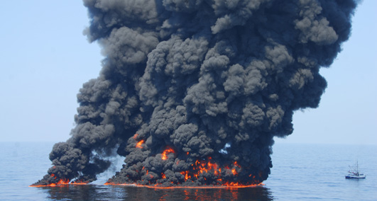 A controlled burn of oil from the Deepwater Horizon/BP oil spill sends towers of fire hundreds of feet into the air over the Gulf of Mexico. June 9. (U.S. Coast Guard Photo / PO1 John Masson)