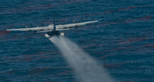 A U.S. Air Force chemical dispersing C-130 aircraft from the 910th Airlift Wing at Youngstown-Warren Air Reserve Station, Ohio, drops an oil dispersing chemical into the Gulf of Mexico as part of the Deepwater Horizon Response effort, May 5, 2010. The 910th AW specializes in aerial spray and is the Department of Defense's only large area fixed wing aerial spray unit. (U.S. Air Force Photo / Tech. Sgt. Adrian Cadiz)