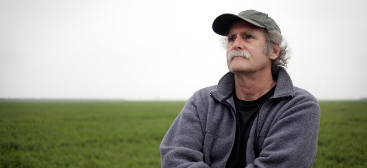 Tom Frantz, in his farm fields in Kern County, CA. (Photo: Chris Jordan / Earthjustice)