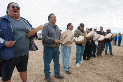 Tribal members greet the bison herd, as they arrive at Ft. Peck. (Ted Wood)