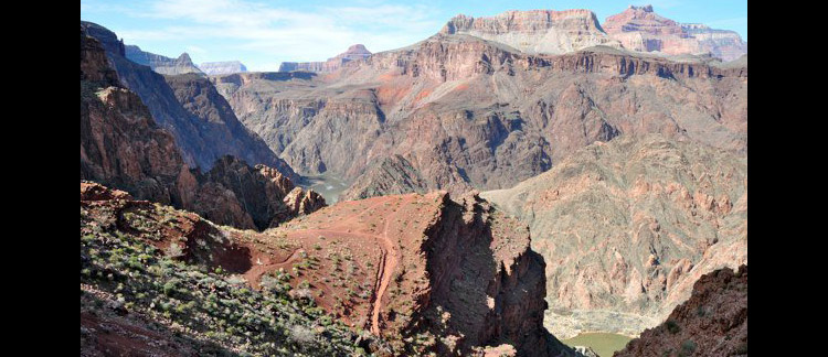 Glimpses of the Colorado River from the Kaibab trail. Over millions of years, the river has carved through uplifting mountain ranges and petrified dunes, and gouged the great gash now known as the Grand Canyon.   (Chrissy Pepino)
