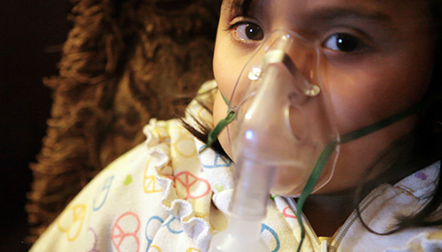 Child suffering from asthma. (Chris Jordan-Bloch / Earthjustice)