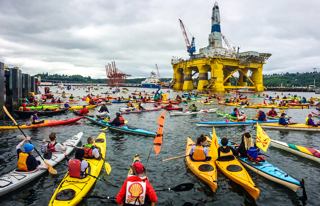 A flotilla of hundreds of kayaktivists swarm the Polar Pioneer, one of Shell's Arctic drilling rigs, as it arrives in Elliot Bay at the Port of Seattle in May 2015.