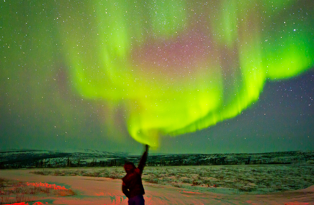 Reaching for the aurora borealis in the Arctic Circle.