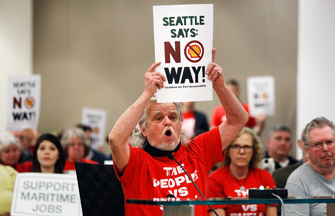 Seattle resident Jack Smith urges the Port of Seattle commissioners to reverse the lease agreement with Shell's Arctic drilling fleet, during a meeting in March 2014.