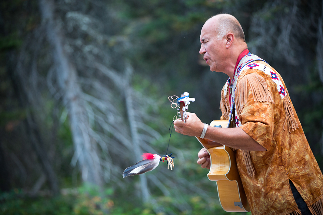 Gladstone performs at Two Medicine campground. The campground is on the border of Glacier National Park and the Badger-Two Medicine area. He uses songs and storytelling to communicate certain Blackfeet and Tribal history and values to audiences throughout the country.