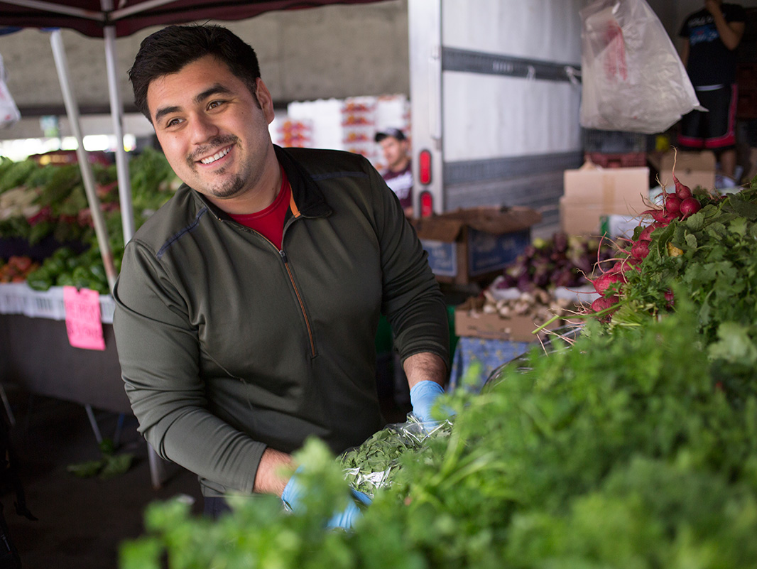 Noel Ledesma, working at the Saturday Oakland farmer's market.
