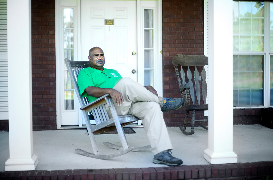 Smith sits on his porch near Tallassee, AL.