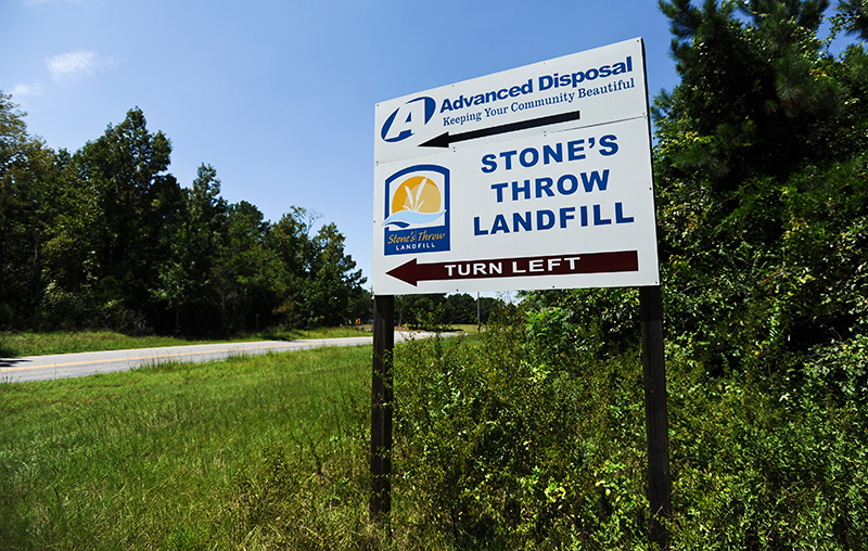The sign for Stone's Throw reads: 'Keeping Your Community Beautiful.'