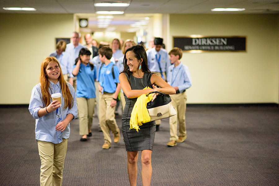 Andrea Delgado walked with young scientist Emma Turgeon and her Hyperbolics team members through the Dirksen Senate Office Building.