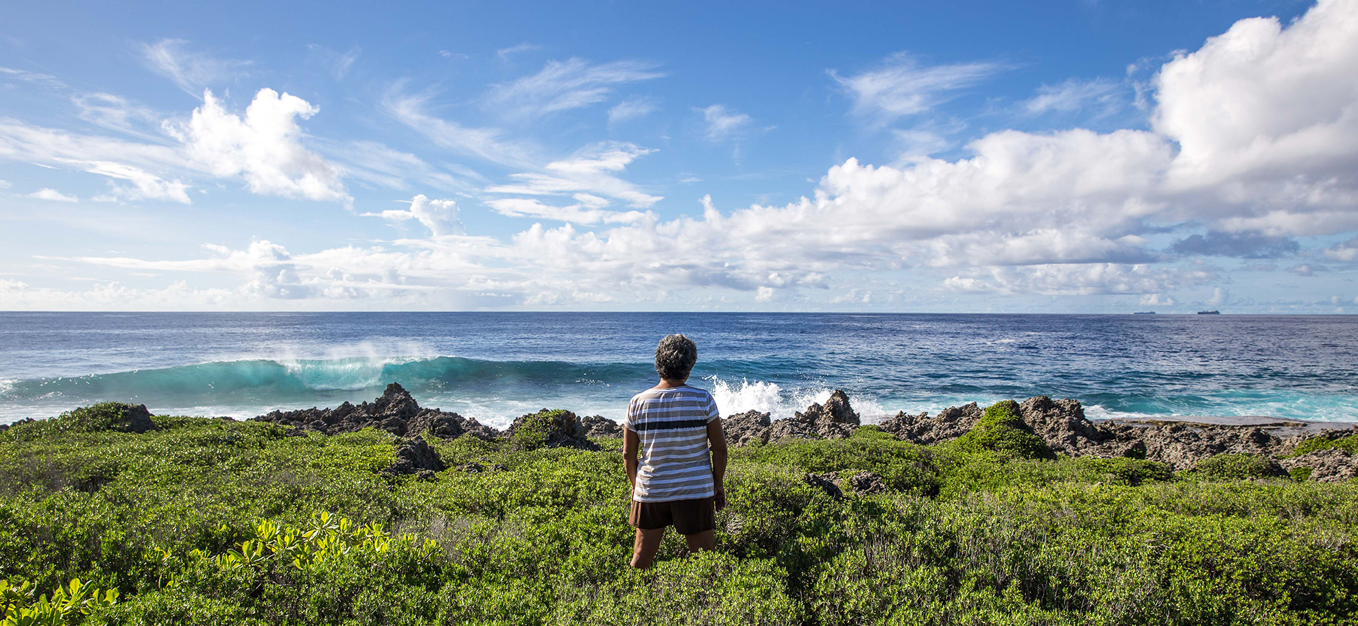 Deborah Fleming looks out onto the Pacific Ocean from the island of Tinian on August 8.