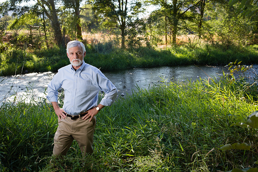 Todd stands by an Idaho creek that flows into critical salmon habitat.