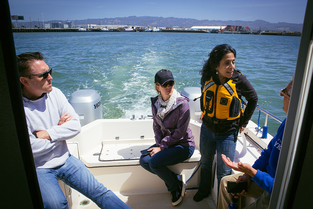 Choksi-Chugh (second from right), leads a boat tour of the proposed coal export facility.