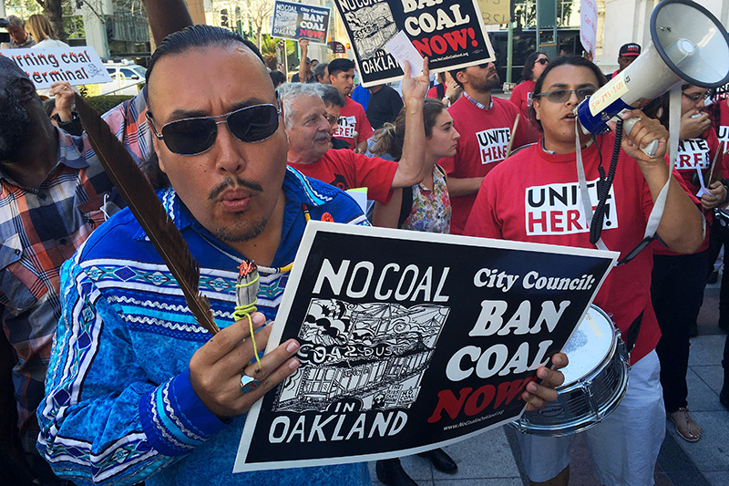 Opponents of the coal export proposal rally outside of Oakland City Hall before the City Council vote, on June 27, 2016.