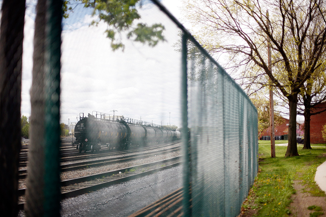 Railroad tank cars, on the track adjacent to Ezra Prentice Homes.