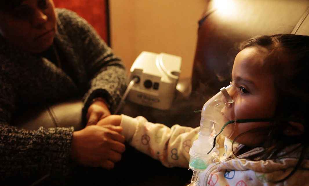 A child receives treatment for asthma. Inhaling fine particulate matter can cause a host of negative health impacts, including heart and lung disease, and asthma.