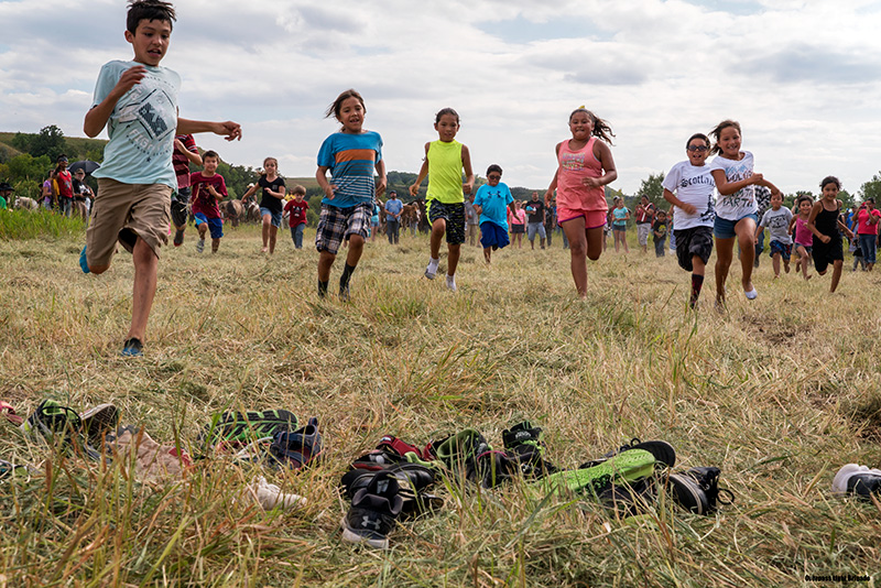 Children race at the Oceti Sakowin camp during autumn.