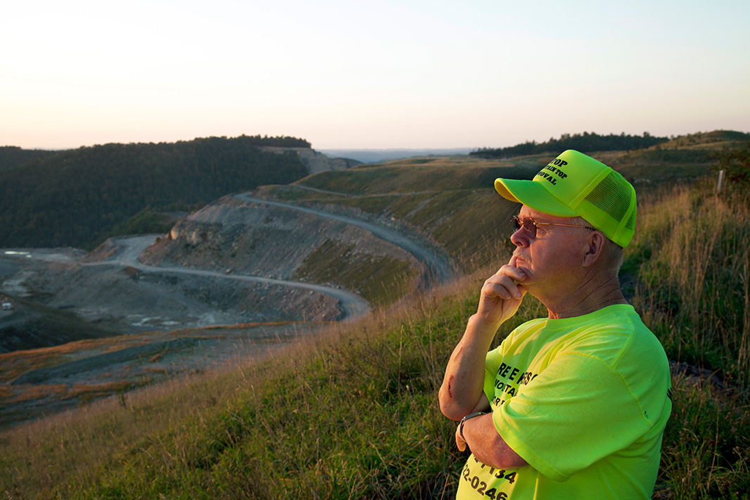 Larry Gibson, activist and lifelong West Virginia resident, looks out over the devastated landscape of Kayford Mountain, which is adjacent to his home and where mountaintop removal coal mining has destroyed much of the celebrated scenery.