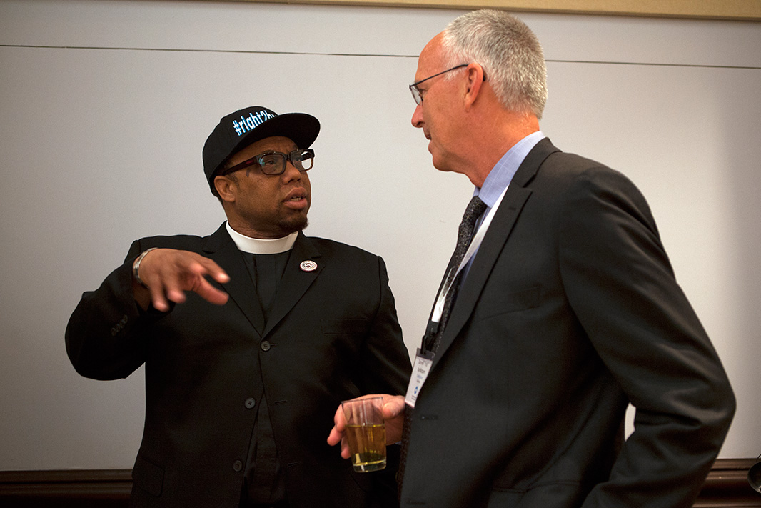 Reverend Lennox Yearwood Jr. (left) of the Hip Hop Caucus speaks with Earthjustice President Trip Van Noppen at the 2013 '50 States United for Healthy Air' event in Washington, D.C.