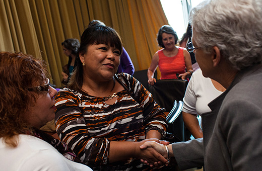 EPA Administrator Gina McCarthy (right) is thanked by Ana Alicia Torres Aguirre, a farmworker and worker safety trainer from Arizona, for listening to the farmworkers' experiences.