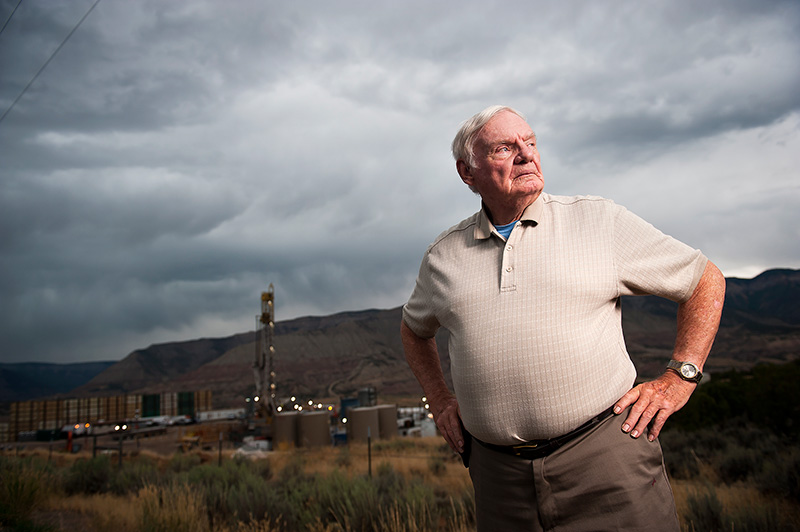 Bob Arrington, a native born Coloradoan, next to a drilling rig near his home in Battlement Mesa, Colorado.