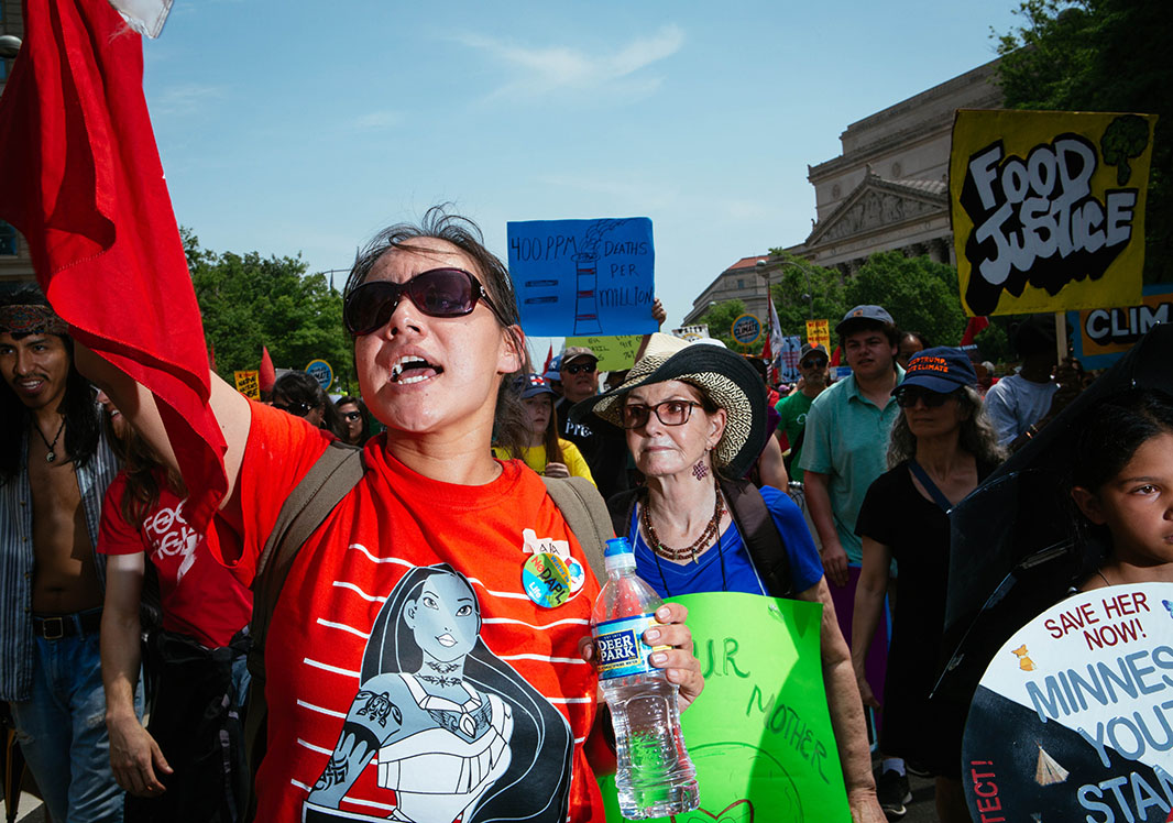 Sara Wescott of the Menominee Reservation in Wisconsin walks in the Peoples Climate March.
