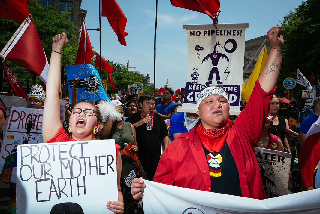 Rose Whipple, left, of St. Paul, Minnesota, marches for our Earth, next to her friend Amber Cross of Bemidji, Minnesota.