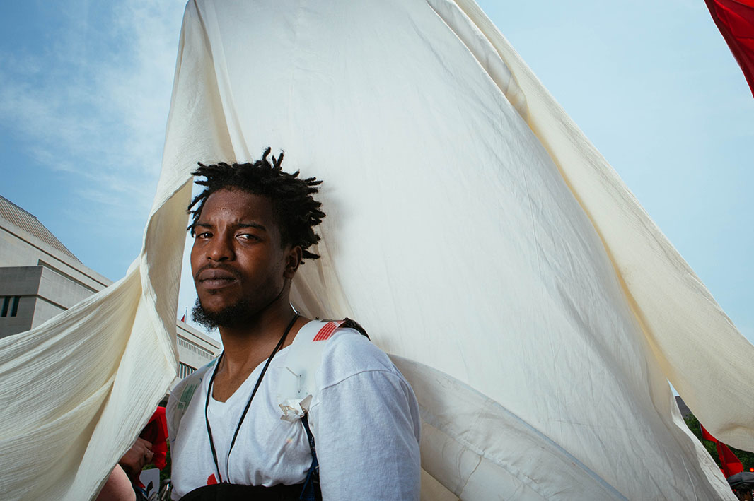 Stanley Morgan, an urban farmer from Philadelphia, PA, stands at the front of the Peoples Climate March.
