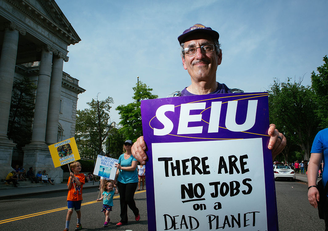 John Grossman, a member of SEIU 509, marches with a contingent of SEIU workers in the Peoples Climate March.